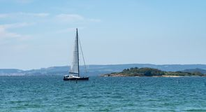 Panoramic view of a Luxury Yatch sailing in the sea royalty free stock photos