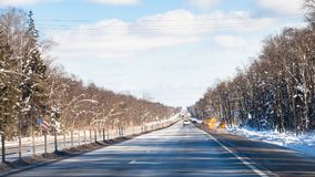 Panoramic view of M1 highway in Russia in winter. Panoramic view of M1 highway (Russian route M1, Belarus Highway, European route E30) in Smolensk oblast of Royalty Free Stock Photography
