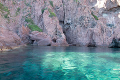 Panoramic view of Magmatic vertical rocks of Calanques de Piana. In Porto Bay of Corsica Island seen from a boat stock images