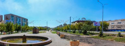 Panoramic View on main Avenue Alley covered by Houses, Threes, Lanterns and Stores. Located in Temirtau, Kazakhstan stock photos