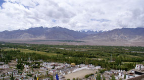 Panoramic view of the majestic Himalayas with greenery at the foothills. On the outskirts of the town of Leh Royalty Free Stock Photography