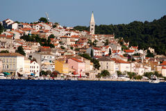 Panoramic view at the Mali Losinj city,Croatia. Seafront view on Mali Losinj coastline with the with houses in background in sunny summer day Royalty Free Stock Image