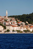 Panoramic view at the Mali Losinj city,Croatia. Seafront view on Mali Losinj coastline with the with houses in background in sunny summer day Royalty Free Stock Images