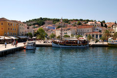 Panoramic view at Mali Losinj harbour,Croatia. Sea view on the houses, old wooden sailboat and main square in Mali Losinj in a sunny summer afternoon Stock Photo