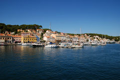 Panoramic view at Mali Losinj harbour,Croatia. Panoramic waterfront view on the houses, motorboats and yachts in Mali Losinj in a sunny summer day with blue sky Royalty Free Stock Photos