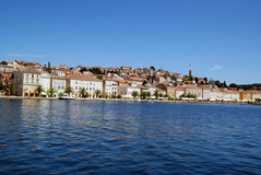 Panoramic view at Mali Losinj harbour,Croatia. Panoramic waterfront view on the houses and waterfront in Mali Losinj in a sunny summer day with blue sky Stock Image