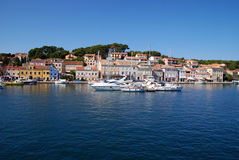 Panoramic view at Mali Losinj harbour,Croatia. Panoramic waterfront view on the houses, and yachts in Mali Losinj in a sunny summer day with blue sky and Royalty Free Stock Photo
