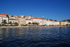 Panoramic view at the Mali Losinj seafront,Croatia. Seafront view on Mali Losinj with houses in background in sunny summer day Stock Photo