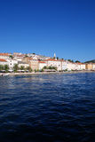 Panoramic view at the Mali Losinj seafront,Croatia. Seafront view on Mali Losinj with houses in background in sunny summer day with blue sky and adriatic sea Stock Photo