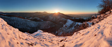 Panoramic view with man in winter mountain Stock Photography