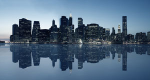 Panoramic view of Manhattan skyline. At dusk over Hudson River with skyscrapers Stock Photos