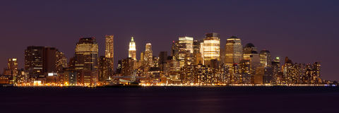 Panoramic view  of Manhattan Skyline by night Stock Photography