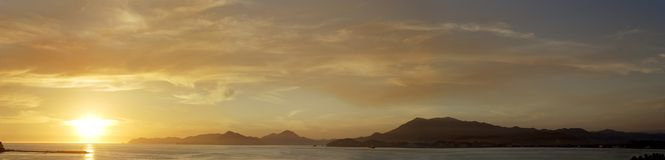 Panoramic View in Manzanillo. Panoramic sunset view of Manzanillo Bay in Manzanillo port city, Mexico Stock Photos