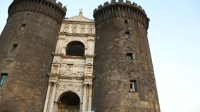 Panoramic view of marble triumphal arch of the Angevin castle, Naples landmark. Stock footage stock video footage