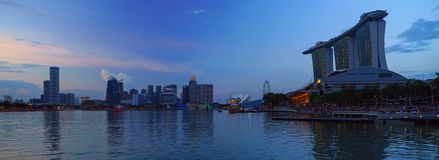 Panoramic view of Marina bay harbor with famous Marina Bay Sands hotel at late evening, Singapore. Royalty Free Stock Photography