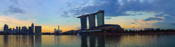 Panoramic view of Marina bay harbor with famous Marina Bay Sands hotel at sunset time, Singapore. Stock Image