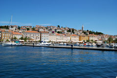 Panoramic view with marina in Mali Losinj harbour,Croatia. Seafront view on Mali Losinj harbour with the with houses in background in sunny summer day Royalty Free Stock Photo