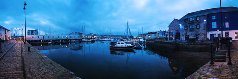 Panoramic view on marina quay in Plymouth, UK at sunrise. stock photos