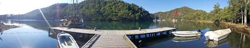 Marmaris Longoz Bay. A panoramic view of Marmaris Longoz Bay with a wooden landing stock photography