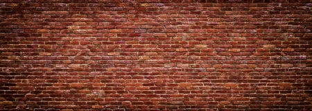 Panoramic view of masonry, brick wall as background. Brick wall of red color, wide panorama of masonry Royalty Free Stock Photos