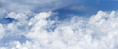 Panoramic view of the massif of the cumulus clouds. Stock Photography