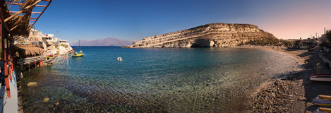 Panoramic view of Matala beach at sunrise in Crete Island, Greece Stock Photography
