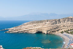 Panoramic view of Matala caves and Matala beach on Crete, Greece. Stock Photography