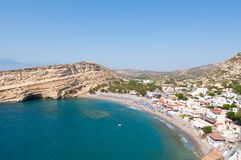 Panoramic view of Matala sandy beach with caves near Heraklion town on Crete, Greece Royalty Free Stock Photography