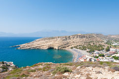 Panoramic view of Matala sandy beach and village on the island of Crete, Greece. Royalty Free Stock Photography