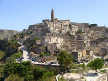 Panoramic view of Matera, Italy. A panoramic view over the sassi district of Matera in Italy's southern region of Basilicata. The cathedral spire towers over the Stock Photo