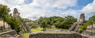 Panoramic view of Mayan Temples of Gran Plaza or Plaza Mayor at Tikal National Park - Guatemala. Panoramic view of Mayan Temples of Gran Plaza or Plaza Mayor at royalty free stock images