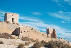 Panoramic view of medieval moorish fortress Alcazaba in Almeria. And beautiful blue sky on the background, Andalusia, Spain Royalty Free Stock Photo