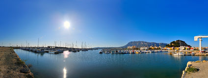 Panoramic view of a mediterranean city. With the harbor and a blue clear sky stock photo