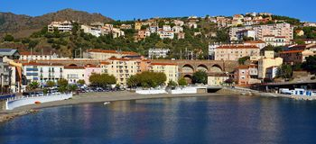 Panoramic view on a Mediterranean town with beach. Panoramic view on the Mediterranean village of Cerbere and its beach, Vermilion coast, Roussillon, France Royalty Free Stock Photos