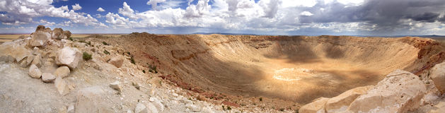 Panoramic view of Meteor Crater - Arizona. This panoramic high-resolution image of the meteor crater has been taken during an afternoon and a storm was brewing Royalty Free Stock Images