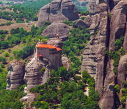 Panoramic view of Meteora monastery on the high rock and road in the mountains at spring time, Greece Royalty Free Stock Photo