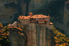 Panoramic view of Meteora monastery on the high rock and road in the mountains at spring time, Greece Stock Photo