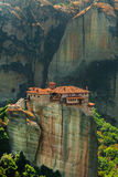 Panoramic view of Meteora monastery on the high rock and road in the mountains at spring time, Greece Royalty Free Stock Photography