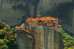Panoramic view of Meteora monastery on the high rock and road in the mountains at spring time, Greece Stock Images