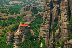 Panoramic view of Meteora monastery on the high rock and road in the mountains at spring time, Greece Royalty Free Stock Photos