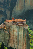 Panoramic view of Meteora monastery on the high rock and road in the mountains at spring time, Greece Royalty Free Stock Image