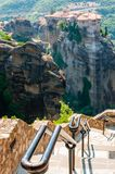 Panoramic view from Meteoron Monastery cliff stone stairs with metal railings on scenic Meteora landscape rock formations with. Meteora, Greece - June 16, 2013 royalty free stock image