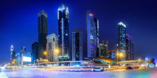 Panoramic view of metro station and road in Financial district at night, Dubai, UAE royalty free stock photography