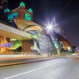 Panoramic view of metro station and road in Financial district at night, Dubai, UAE Stock Photos