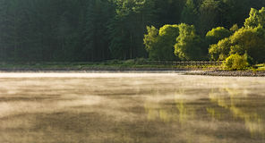 Panoramic View Of Mist Rising From Lake. Stock Photo