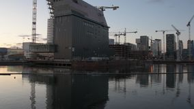 Panoramic view of the modern buildings known as Barcode Project under construction. In the center of Oslo at the sunset stock video