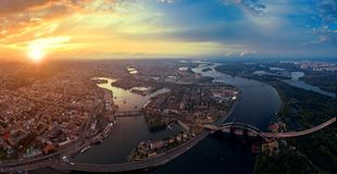 Panoramic aerial view of the old part of the city - Podol district. View of the Rybalsky Island at sunset. Royalty Free Stock Images