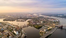Panoramic aerial view of the old part of the city - Podol district. View of the Rybalsky Island at sunset. Stock Images