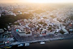 Panoramic view of a modern city at sunset. Postal square, Podol district, city center of Kiev, Ukraine. Aerial view Stock Photos