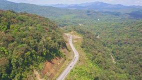 Panoramic view modern empty mountain road among jungle stock video